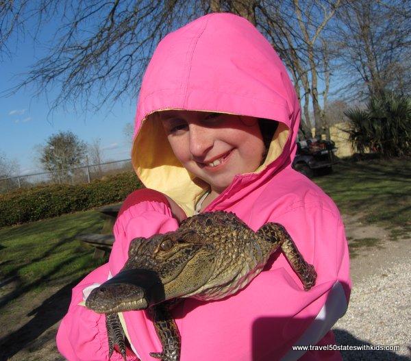 Holding a cute cuddly alligator