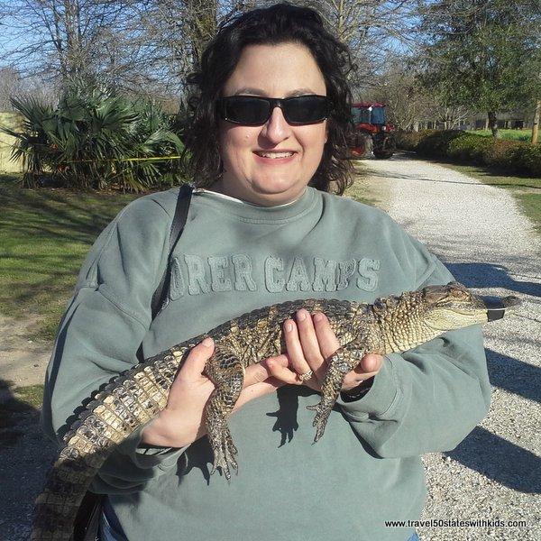 Terri Weeks holding an alligator