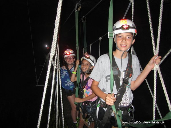 Crossing a rope bridge at Louisville MEGA Zips