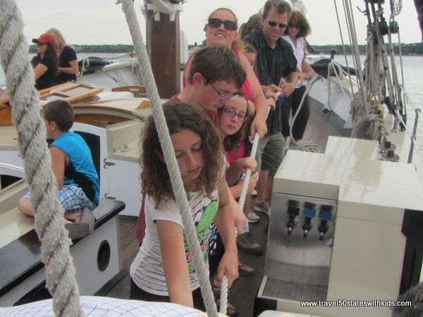 Passengers working to raise the sails - Tall Ship Manitou