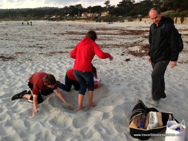 Preparing to make a fire on Carmel Beach