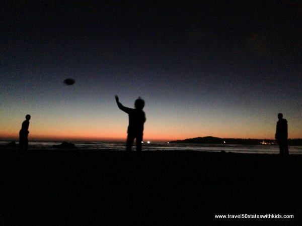 Tossing a frisbee on Carmel Beach at sunset