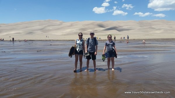 Wading across creek at Great Sand Dunes National Park